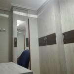 armario de rincon en melamina con espejo